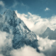 Manaslu mountain with snowy peak in clouds in sunny bright day - PhotoDune Item for Sale