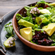 Clay dish with salad of avocado, green and violet lettuce, lamb' - PhotoDune Item for Sale