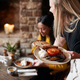 Close Up Of Waitress Working In Traditional English Pub Serving Breakfast To Guests - PhotoDune Item for Sale