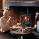 Couple Sitting At Table Drinking Tea In Traditional English Holiday Hotel - PhotoDune Item for Sale