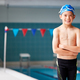 Portrait Of Boy Standing By Edge Of Swimming Pool Ready For Lesson - PhotoDune Item for Sale