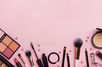 Frame with professional decorative cosmetics on pink