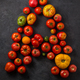 Letter A made with ripe tomatoes on a black background, creative flat lay healthy food concept - PhotoDune Item for Sale