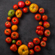 Letter O made with ripe tomatoes on a black background, creative flat lay healthy food concept - PhotoDune Item for Sale