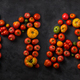 Tomato word made with ripe tomatoes on a black background, creative flat lay healthy food concept - PhotoDune Item for Sale