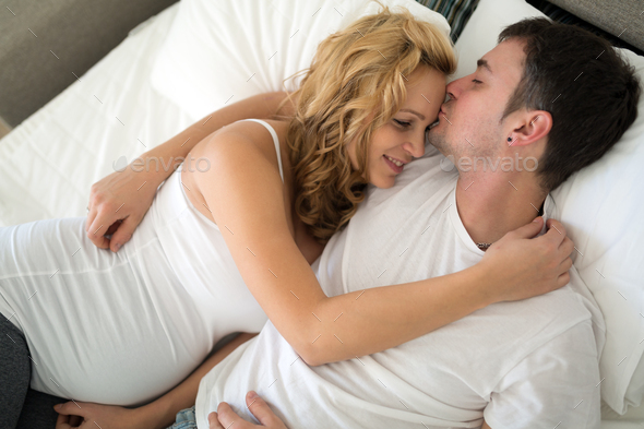 Happy pregnant woman relaxing with her husband - Stock Photo - Images