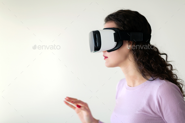 Beautiful woman virtual trying reality glasses at home - Stock Photo - Images