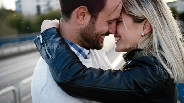 Romantic young happy couple kissing and hugging - Stock Photo - Images