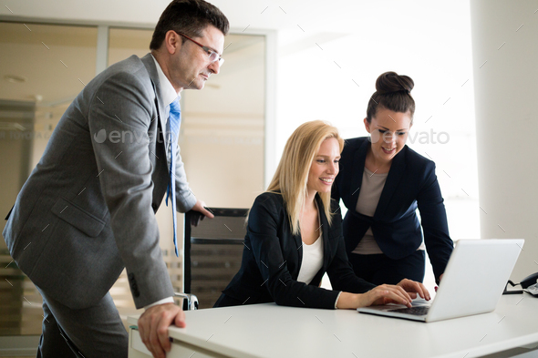 Picture of sales agents working together in office - Stock Photo - Images