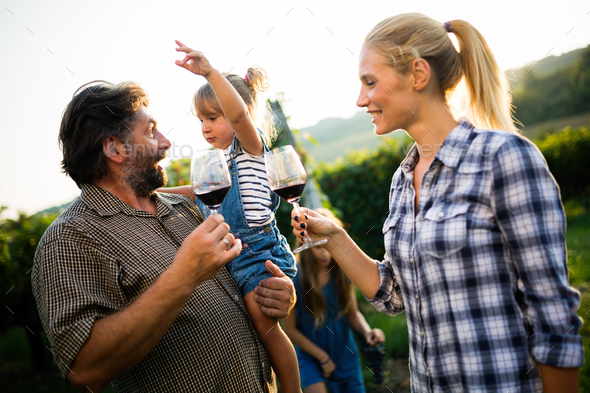Portrait of happy people spending time in vineyard - Stock Photo - Images