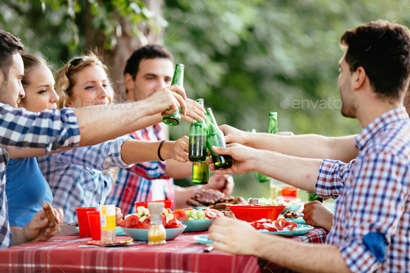 Young people in nature having fun and smiling - Stock Photo - Images