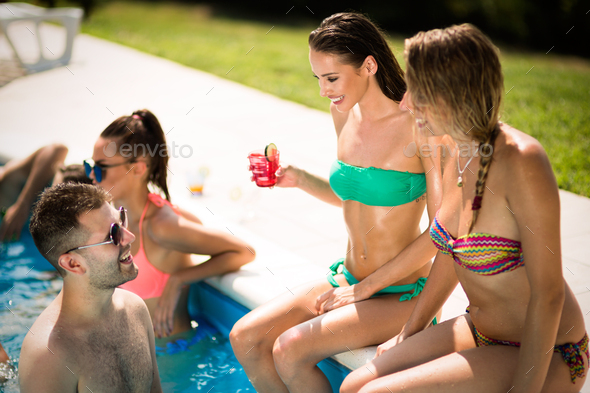 Group of people partying in pool - Stock Photo - Images