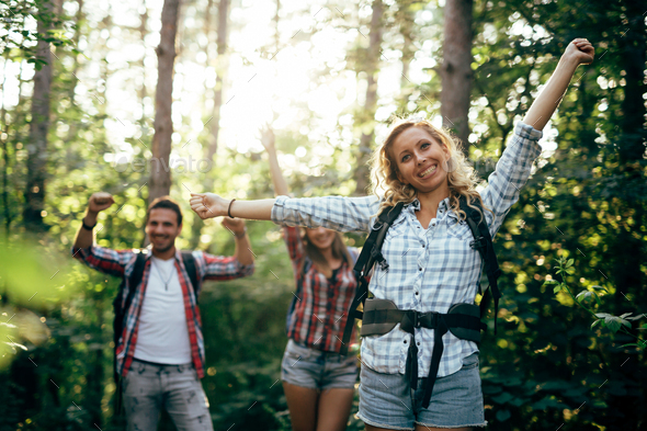 Young couple trekking and hiking in forest - Stock Photo - Images