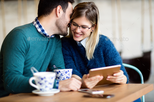 Young attractive couple on date in coffee shop - Stock Photo - Images