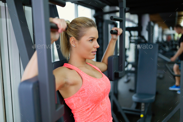 Beautiful young woman doing exercises for chest - Stock Photo - Images