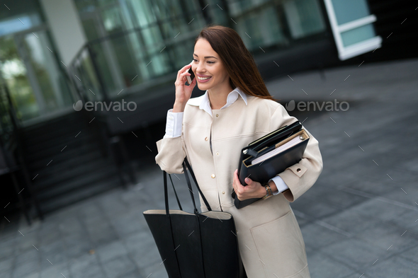 Professional beautiful and attractive businesswoman talking on cellphone - Stock Photo - Images