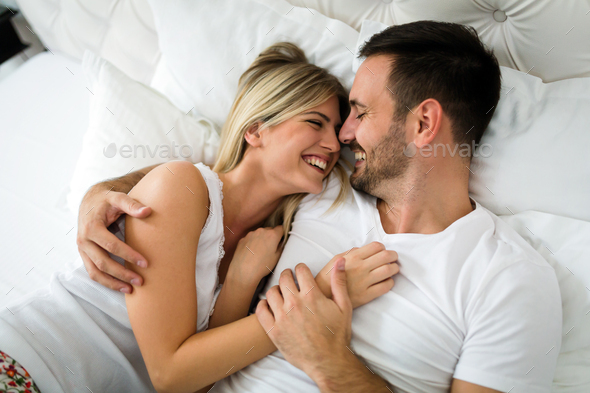 Young couple having having romantic times in bedroom - Stock Photo - Images