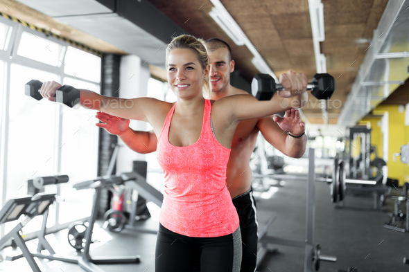 Young attractive woman doing exercises in gym - Stock Photo - Images