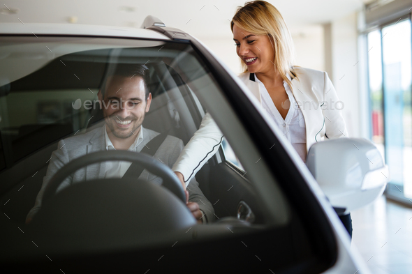 Portrait of happy customer buying new car - Stock Photo - Images