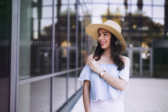 Picture of beautiful smiling girl wearing hat - Stock Photo - Images