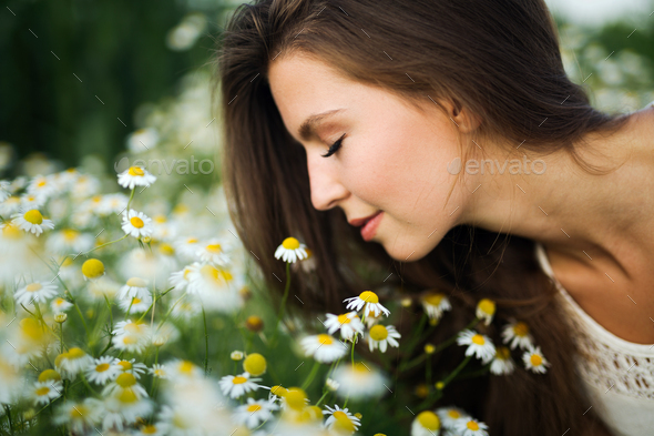 Young beautiful woman spending time in nature - Stock Photo - Images