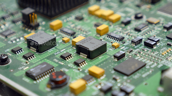 Electronic printed circuit board with many electrical components - Stock Photo - Images