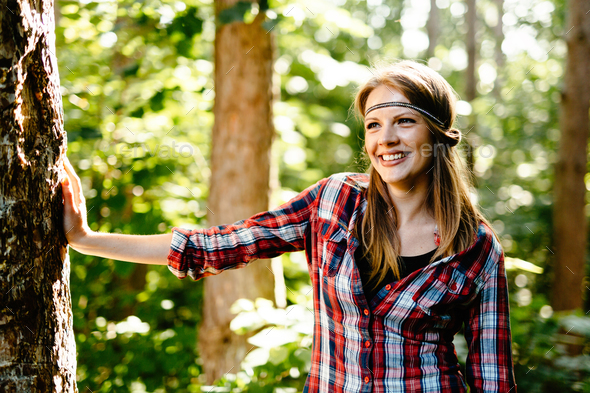 Pretty woman hiking in forest - Stock Photo - Images