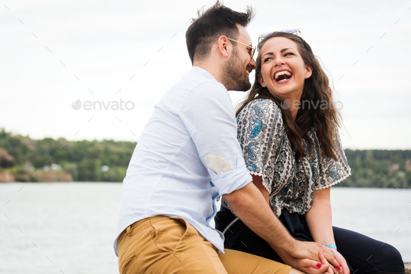 Young attractive happy couple having romantic date - Stock Photo - Images