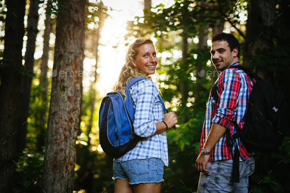 Happy couple trekking and hiking in forest - Stock Photo - Images