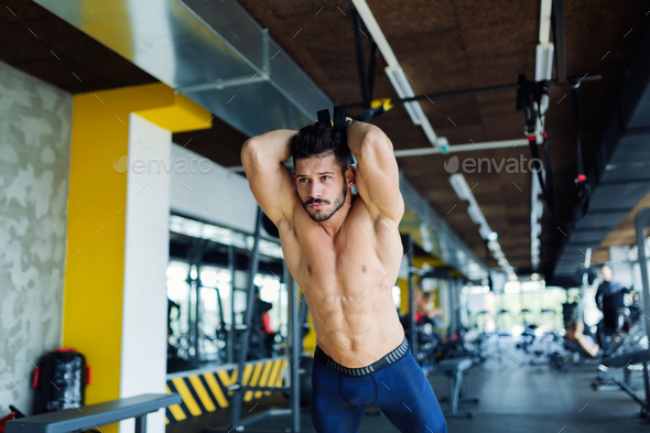 Young man doing trx exercise in gym - Stock Photo - Images