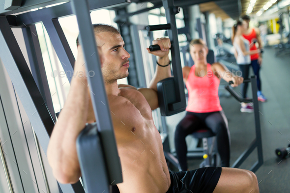 Attractive man and beautiful woman workout in gym - Stock Photo - Images