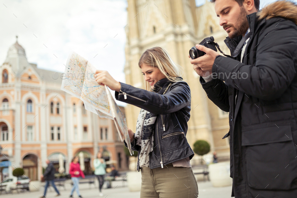 Young attractive happy couple enjoying city as tourists - Stock Photo - Images