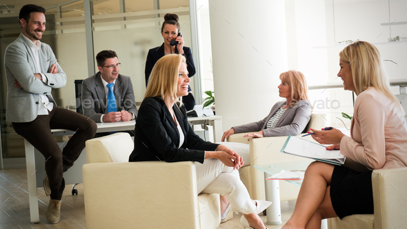 Businesspeople discussing together in conference room during meeting at office - Stock Photo - Images