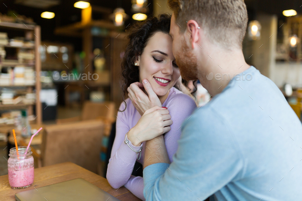 Young happy couple on date in coffee shop - Stock Photo - Images