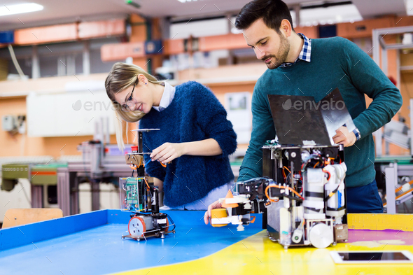 Young students of robotics working on project - Stock Photo - Images