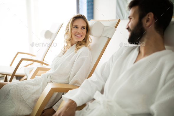 Beautiful woman and handsome man relaxing in spa center - Stock Photo - Images