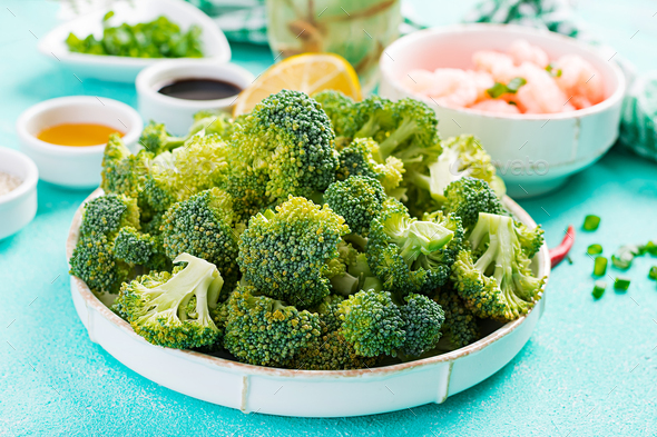 Ingredients for cooking stir fry shrimp with broccoli close up on a table. Prawns and broccoli. - Stock Photo - Images