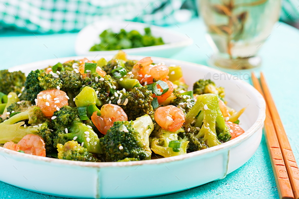 Stir fry shrimp with broccoli close up on a plate. Prawns and broccoli. - Stock Photo - Images