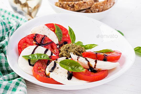 Traditional Italian Caprese Salad with mozzarella, tomato, basil and balsamic vinegar - Stock Photo - Images