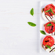 Sandwiches with mozzarella, tomatoes and rye bread on white wooden table. Top view - PhotoDune Item for Sale