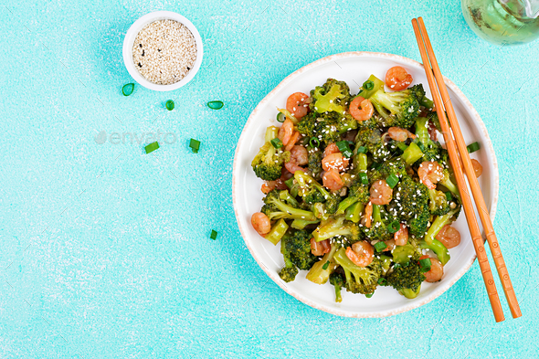 Stir fry shrimp with broccoli close up on a plate. Prawns and broccoli.  Top view, overhead - Stock Photo - Images