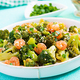 Stir fry shrimp with broccoli close up on a plate. Prawns and broccoli. - PhotoDune Item for Sale