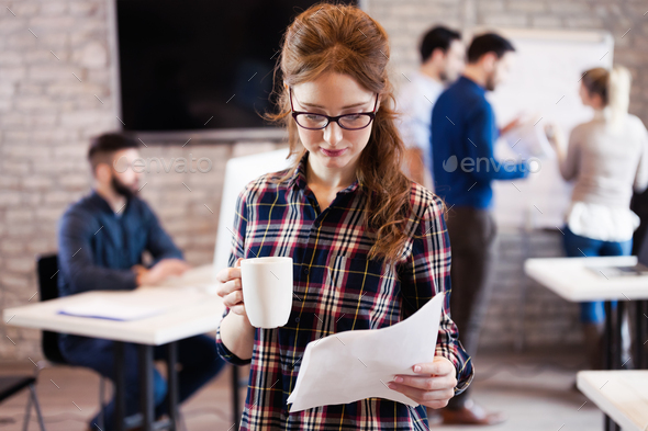 Portrait of young beautiful architect in office - Stock Photo - Images