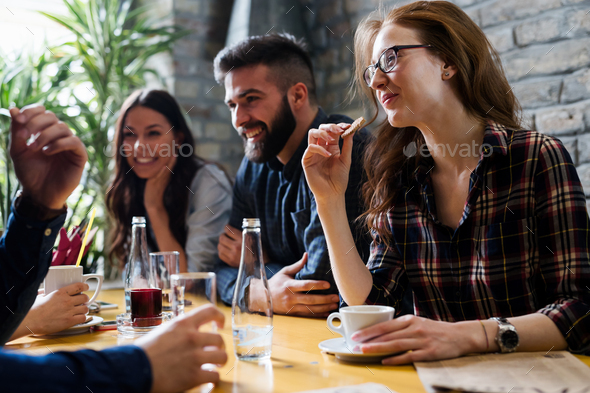 Happy young friends hangout in coffee shop - Stock Photo - Images