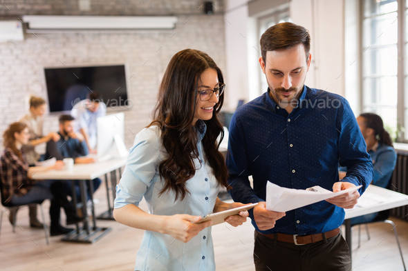 Portrait of young architects discussing in office - Stock Photo - Images