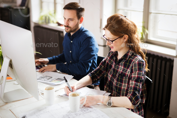 Picture of architects working together in office - Stock Photo - Images