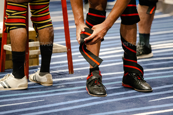 legs athlete powerlifter in knee wraps at powerlifting competition - Stock Photo - Images
