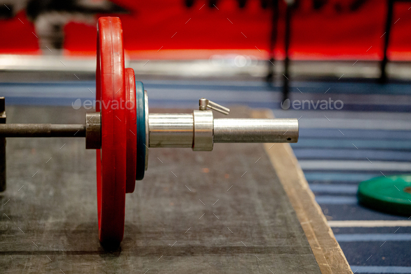 bar with plates on ground for deadlift competition - Stock Photo - Images