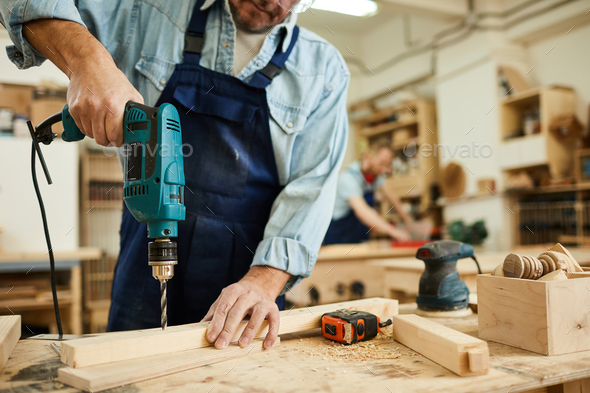 Carpenter Drilling Wood - Stock Photo - Images