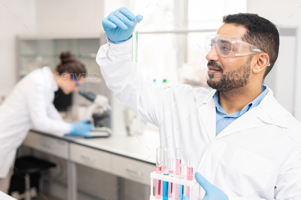 Content chemist analyzing sample - Stock Photo - Images
